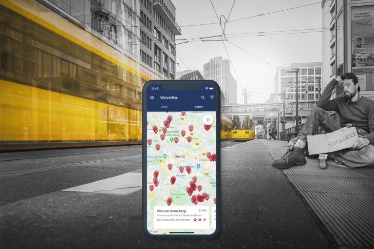 Strassenbild von Berlin, Obdachloser und Screen der Berliner Wohnhilfen App